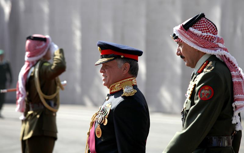 "King Abdullah II of Jordan, center, reviews the honor guard on his arrival for the parliament's opening session, in Amman, Jordan, Sunday, Nov. 3, 2013. Addressing parliament's opening session Sunday, Abdullah says his ""white revolution"" is part of home-grown reforms he initiated weeks before the outset of the Arab Spring that saw four of his peers deposed in revolutions.(AP Photo/Mohammad Hannon)"