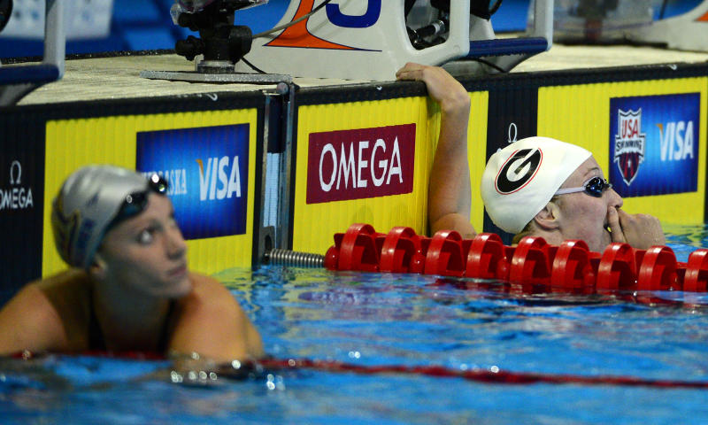 Shannon Vreeland, right, reacts after swimming in a women's 200-meter freestyle semifinal at the U.S. Olympic swimming trials, Wednesday, June 27, 2012, in Omaha, Neb. At left is Dana Vollmer. (AP Photo/Mark J. Terrill)