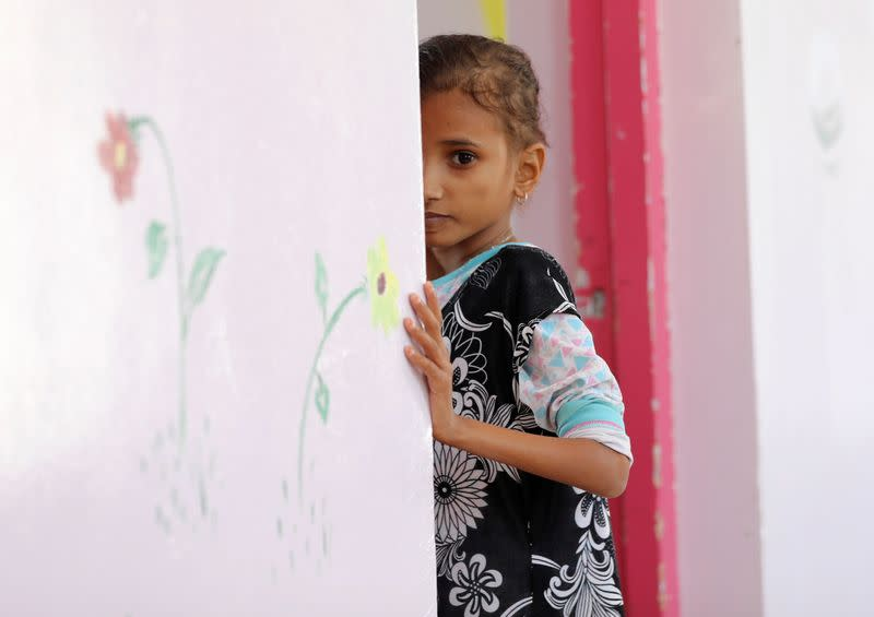 Ahmadiya Juaidi, 13, looks on as she stands at the door of her room at malnutrition treatment ward of al-Sabeen hospital in Sanaa