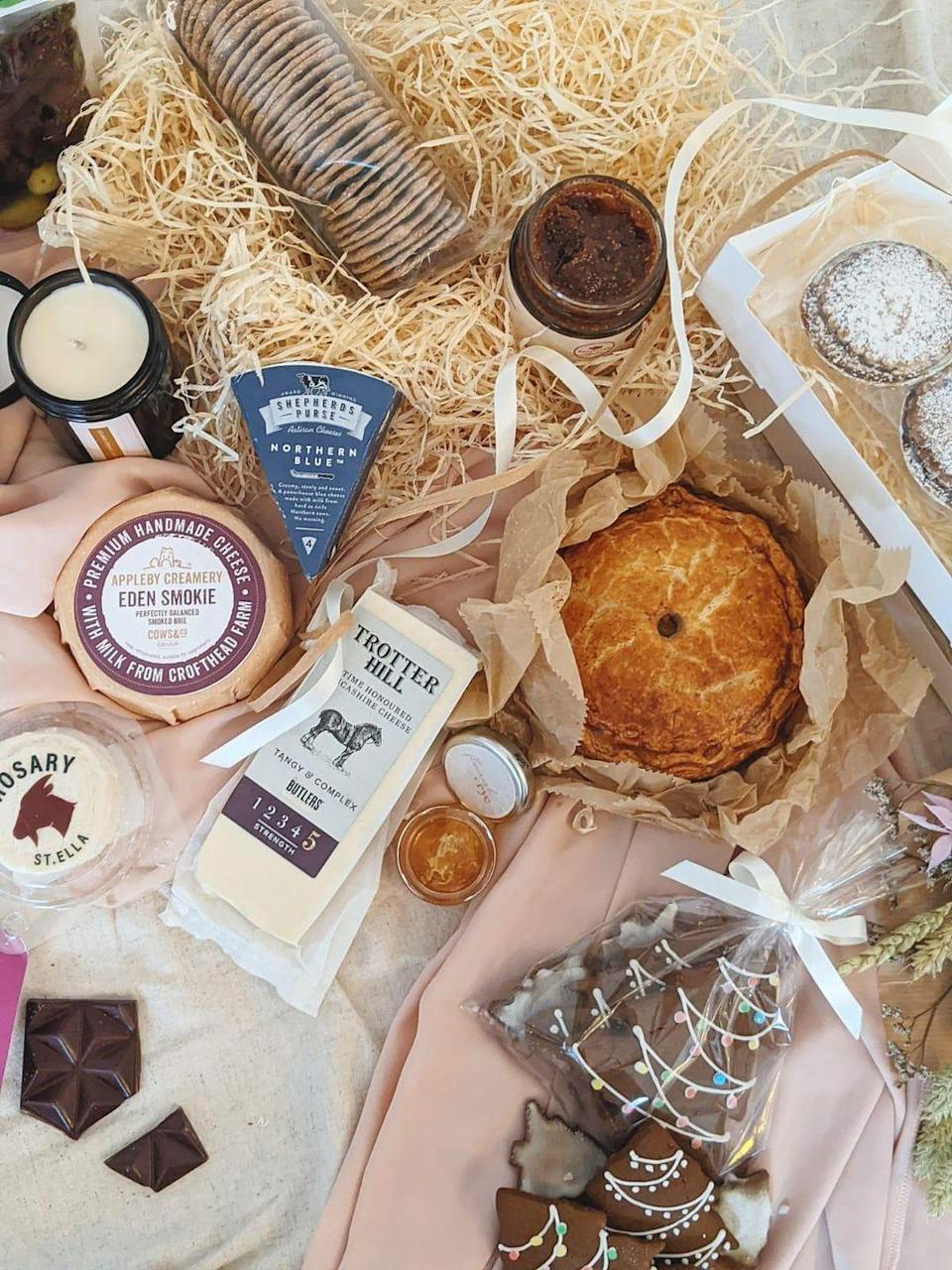 """<p>Flourish + Rye's 'So this is Christmas' hamper, designed to serve four to six people, is filled with everything you need for the perfect festive cheeseboard. Enjoy Northern Blue Shepherds Purse, Smokey Eden Brie and Yorkshire Coppa, alongside chutneys, crackers and olives. Plus, you'll enjoy hand-made treats including six boozy clementine mince pies, spiced ginger biscuits and a chicken, bacon and chestnut Christmas pie. With goods hand-selected from small-scale producers and artisans from across the UK, this is the ultimate foodie festive treat. AD</p><p>£130 including next-day delivery, <a href=""""http://www.flourishandrye.co.uk"""" rel=""""nofollow noopener"""" target=""""_blank"""" data-ylk=""""slk:Flourish and Rye"""" class=""""link rapid-noclick-resp"""">Flourish and Rye</a></p>"""