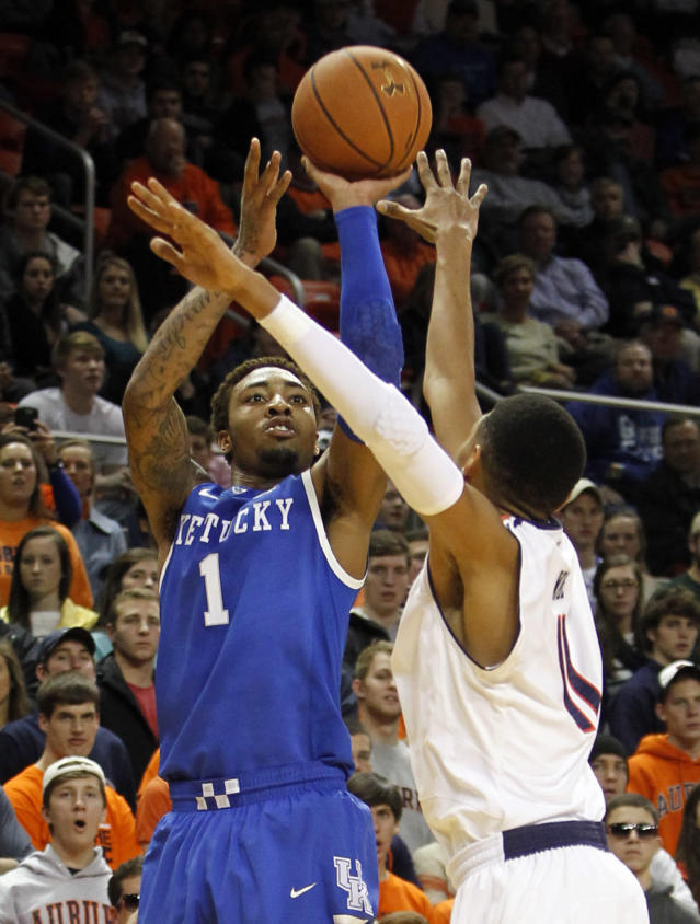 Kentucky's James Young (1) shoots over Auburn's Dion Wade during the first half of an NCAA college basketball game on Wednesday, Feb. 12, 2014, in Auburn, Ala. (AP Photo/Butch Dill)