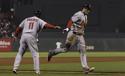 St. Louis Cardinals' David Freese, right, is congratulated by third base coach Jose Oquendo (11) after hitting a solo home run off of San Francisco Giants pitcher Madison Bumgarner during the seventh inning of a baseball game in San Francisco, Wednesday, May 16, 2012. (AP Photo/Jeff Chiu)