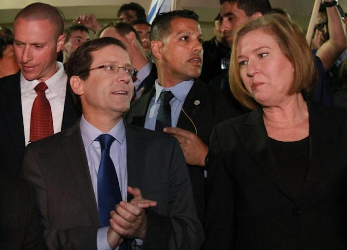 Co-leaders of the Zionist Union party, Israeli Labour Party leader Isaac Herzog (L) and Israeli MP Tzipi Livni, speak to the media in Modiin, March 17, 2015 (AFP Photo/Gil Cohen Magen)