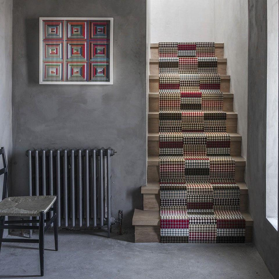 """<p>A joyful mix of colour and geometric diamond pattern makes this Margo Selby carpet a really talking point. When making such a big design statement, consider carpeting a smaller space, such as a hallway or stairs.<br></p><p>Pictured: <a href=""""https://www.alternativeflooring.com/collection/wool/quirky_collection/quirky-patch-by-margo-selby/red.html"""" rel=""""nofollow noopener"""" target=""""_blank"""" data-ylk=""""slk:Margo Selby Quirky Patch Strip Red Runner at Alternative Flooring"""" class=""""link rapid-noclick-resp"""">Margo Selby Quirky Patch Strip Red Runner at Alternative Flooring</a></p>"""