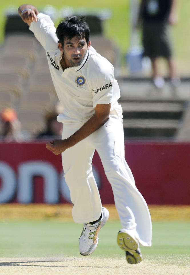 India's Zaheer Khan bowls against Australia during their cricket test match in Adelaide, Australia, Friday, Jan. 27, 2012. (AP Photo/David Mariuz)