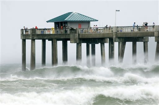 Waves crash against the Okaloosa Island Fishing Pier in Fort Walton Beach, Fla., as wind, waves, and storm from Tropical Storm Debby pound the Florida panhandle Sunday, June 24, 2012. Louisiana's governor declared a state of emergency as the storm threatens to flood low-lying coastal areas. (AP Photo/Northwest Florida Daily, Devon Ravine)