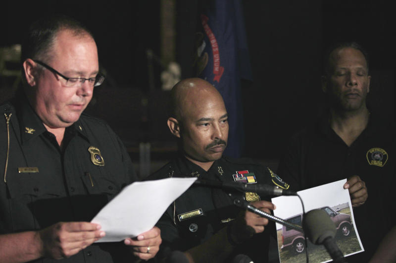 Allen Park, Mich., Police Chief James Wilkewitz, left, reads a statement as Detroit Police Chief Ralph Godbee holds a copy of a of a vehicle the police are looking for in the investigation into the deaths of a man and woman whose decapitated bodies were pulled from the Detroit River and a creek during a news conference in Allen Park, Mich., Friday, July 20, 2012. (AP Photo/Carlos Osorio)