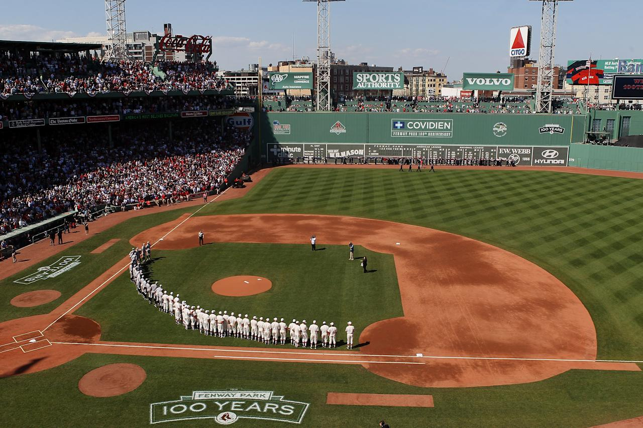 BOSTON, MA - APRIL 20:  The New York Yankees and the Boston Red Sox line up on the field in celebration of Fenway Park's 100 years before the game on April 20, 2012 at Fenway Park in Boston, Massachusetts. Today marks the 100 year anniversary of the ball park's opening.  (Photo by Elsa/Getty Images)