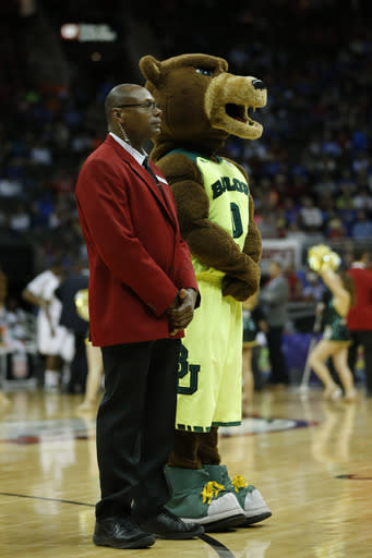 In this photo taken on March 14, 2014, the Baylor mascot stands with Sprint Center floor security during the first half of an NCAA college basketball game against Texas in the semifinals of the Big 12 Conference men's tournament in Kansas City, Mo. Security firms charged with protecting college and professional sports venues are monitoring social media more than ever to prepare for everything from a garden-variety court storming to something much more dangerous. (AP Photo/Orlin Wagner)