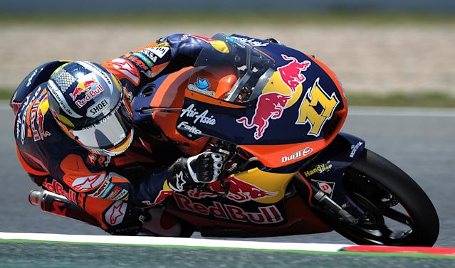 Red Bull KTM Ajo's German Sandro Cortese takes a curve at the Catalunya racetrack in Montmelo, near Barcelona, on June 1, 2012, during the Moto 3 second training session the Catalunya Moto GP Grand Prix. AFP PHOTO/LLUIS GENELLUIS GENE/AFP/GettyImages