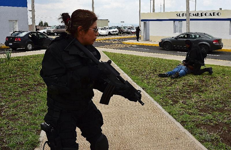 """The US-funded police academy in Amozoc de Mota, Puebla state, home to the """"tactical village"""", is one of a handful in Mexico where federal, municipal and state officers are getting much-needed training (AFP Photo/Ronaldo Schemidt)"""