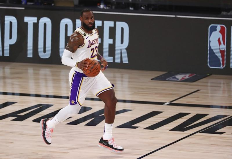 Los Angeles Lakers forward LeBron James (23) brings the ball upcourt against the Utah Jazz during the first half of an NBA basketball game Monday, Aug. 3, 2020, in Lake Buena Vista, Fla. (Kim Klement/Pool Photo via AP)