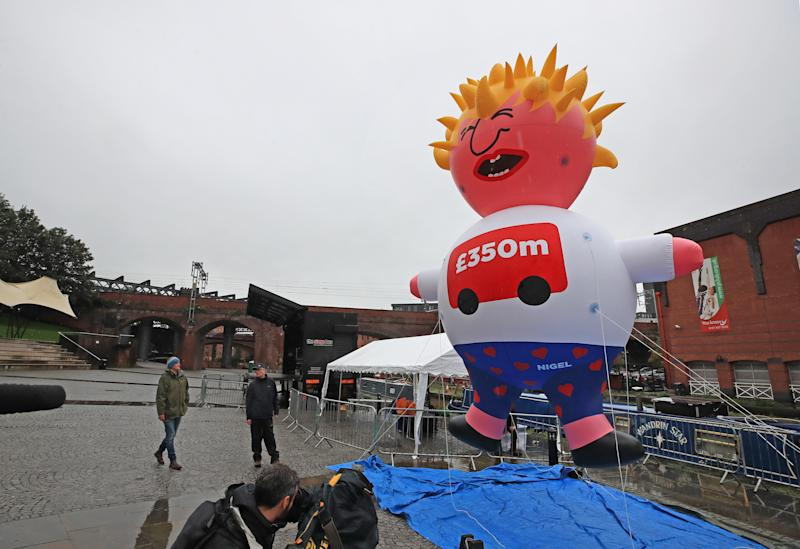 A Boris blimp is inflated at Castlefield Bowl, Manchester as part of the Reject Brexit defend our democracy protest. (Photo by Peter Byrne/PA Images via Getty Images)