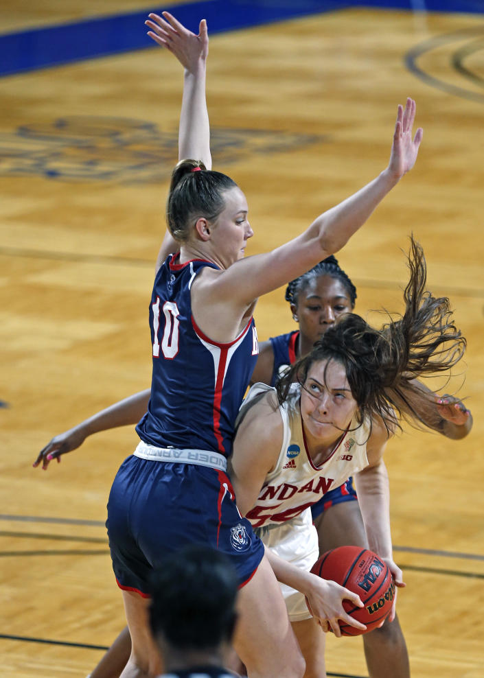 Indiana forward MacKenzie Holmes (54) drives on Belmont forward Allison Luly (10) during the first half of a college basketball game in the second round of the NCAA women's tournament at Greehey Arena in San Antonio on Wednesday, March 24, 2021. (AP Photo/Ronald Cortes)