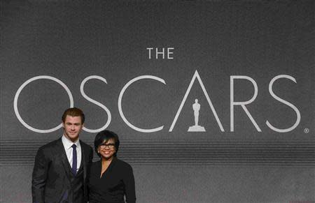 Actor Chris Hemsworth (L) and Academy of Motion Picture Arts and Sciences President Cheryl Boone Isaacs pose for photographers after the 86th Academy Awards nominee announcements in Beverly Hills, California January 16, 2014. REUTERS/Phil McCarten