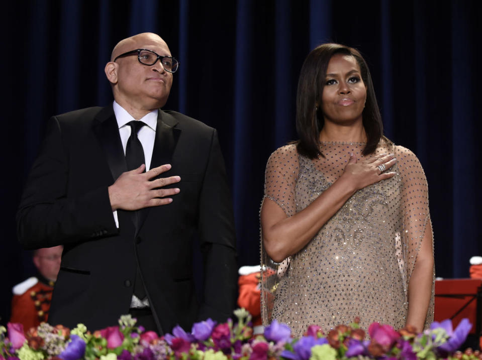 <p>Larry Wilmore, guest host from Comedy Central, and first lady Michelle Obama listen to the national anthem at the annual White House Correspondents' Dinner, April 30. <i>(Photo: Susan Walsh/AP)</i></p>