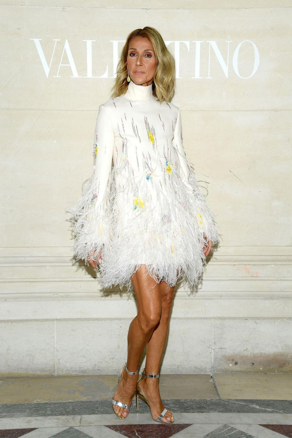 <p>We love the soft waves hairstyle Celine paired with this feathered look for the Valentino show during Paris Couture week. </p>