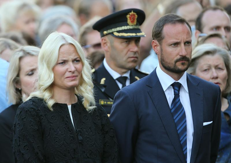 Norwegian Crown Princess Mette-Marit, left, and Crown Prince Haakon, right, attend a memorial ceremony for the victims of bombings and shooting near the site of a heavily damaged building by the bomb attack, in Oslo, Norway, Sunday July 22, 2012. Norway marked the first anniversary of the bombing in government buildings in Oslo, and shooting dead of youths at a Labor Party youth camp on Utoeya island. (AP Photo/NTB Scanpix, Lise Aserud) NORWAY OUT