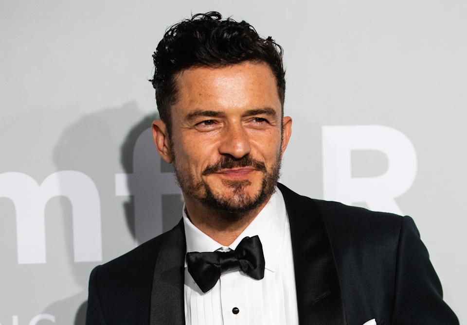 CAP D'ANTIBES, FRANCE - JULY 16: Orlando Bloom attends the amfAR Cannes Gala 2021 during the 74th Annual Cannes Film Festival at Villa Eilenroc on July 16, 2021 in Cap d'Antibes, France. (Photo by Samir Hussein/WireImage)