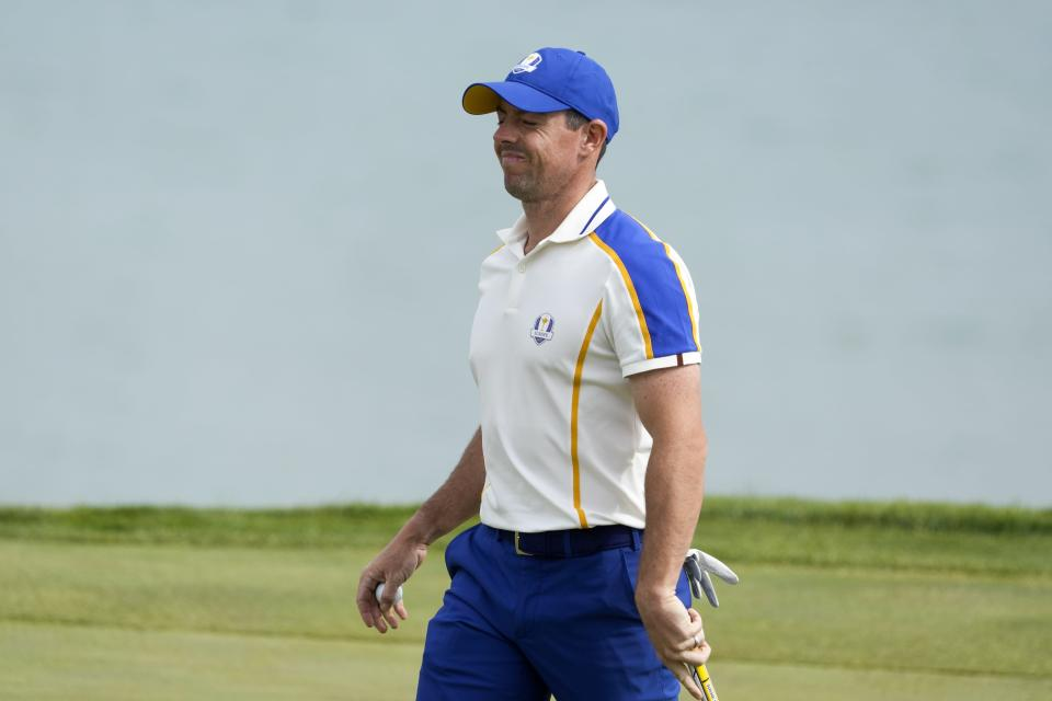 Team Europe's Rory McIlroy reacts to a missed putt on the third hole during a singles match the Ryder Cup at the Whistling Straits Golf Course Sunday, Sept. 26, 2021, in Sheboygan, Wis. (AP Photo/Charlie Neibergall)