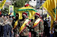 Hezbollah members carry the coffin of a man killed a day earlier by Israeli fire on the frontier with Lebanon during a protest against Israel