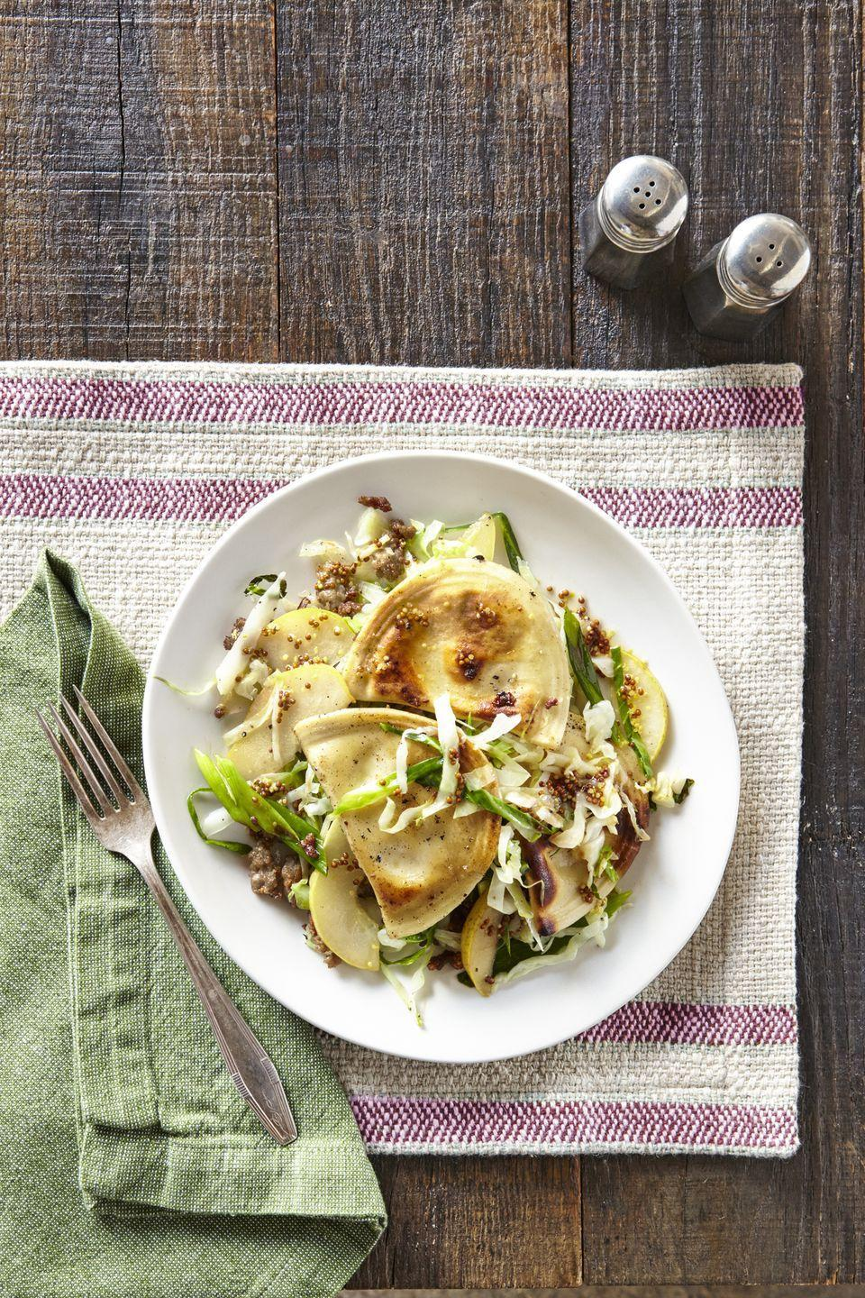 """<p>Pierogies are a great shortcut item that can be found in the freezer section of the grocery store. Steam for a softer texture, or fry if you prefer a few crispy edges.</p><p><strong><a href=""""https://www.countryliving.com/food-drinks/recipes/a39829/pierogies-with-sausage-cabbage-pear-recipe/"""" rel=""""nofollow noopener"""" target=""""_blank"""" data-ylk=""""slk:Get the recipe"""" class=""""link rapid-noclick-resp"""">Get the recipe</a>.</strong></p>"""