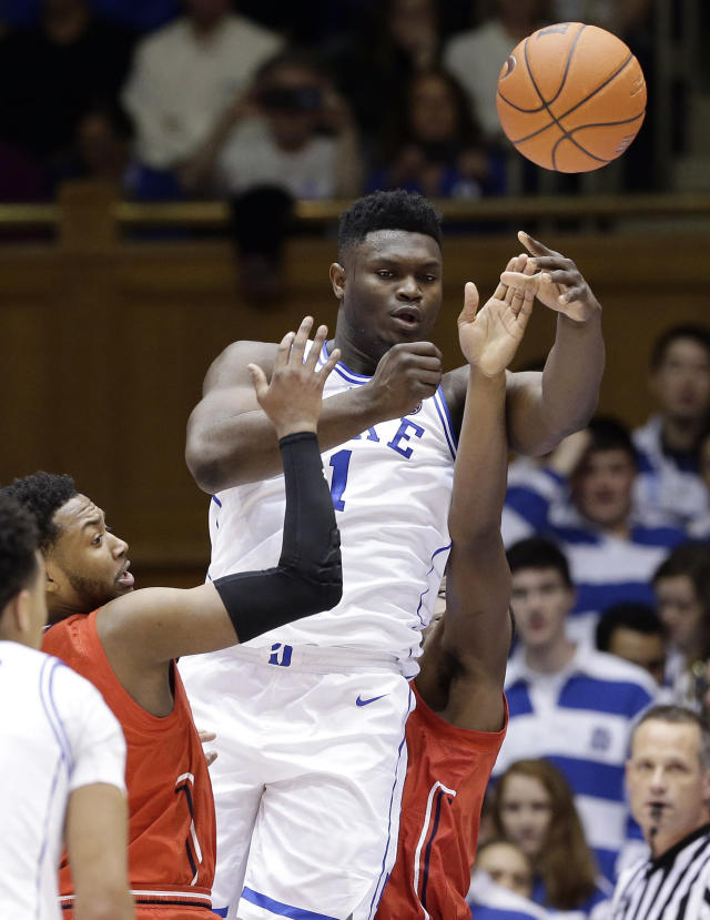 Duke's Zion Williamson (1) passes the ball while St. John's Shamorie Ponds, left, and Mustapha Heron defend during the first half of an NCAA college basketball game in Durham, N.C., Saturday, Feb. 2, 2019. (AP Photo/Gerry Broome)