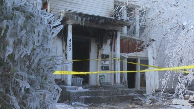 The home was heavily damaged and covered in ice following the fire. (Dan Taekema/CBC - image credit)