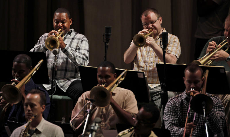 U.S. musician Wynton Marsalis, top left, and members of the Jazz at Lincoln Center Orchestra rehearse in Havana, Cuba, Monday, Oct. 4, 2010. The visit by Marsalis and his Jazz at Lincoln Center Orchestra kicks off a season of unprecedented cultural exchanges, with the American Ballet Theater scheduled to perform in Havana next month in honor of Cuban ballet legend Alicia Alonso.  (AP Photo/Javier Galeano)