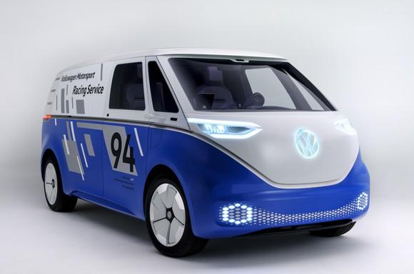 The Volkswagen I.D. BUZZ CARGO, an electric commercial van, painted in the blue and white livery of VW's electric racing car.
