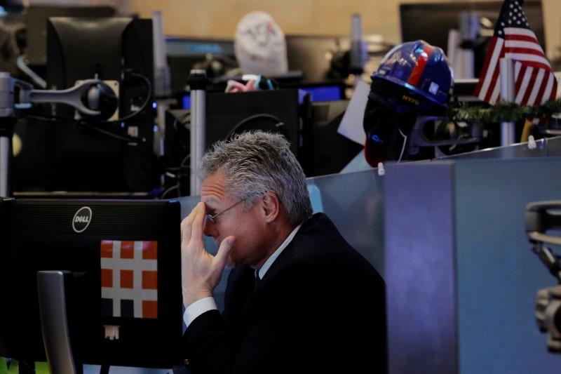 A trader looks at screens while working on the floor of the New York Stock Exchange (NYSE) in New York