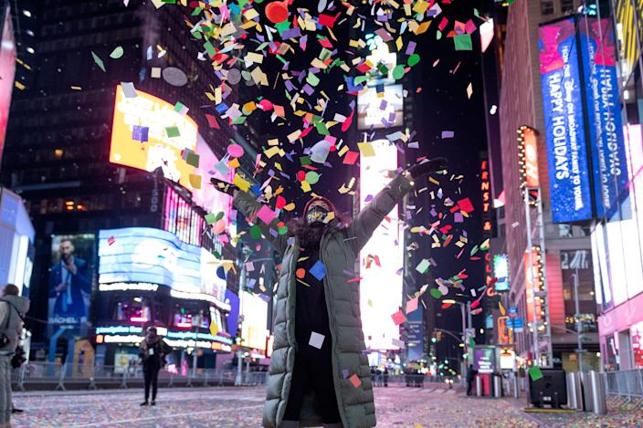 A woman throws confetti during the 2021 New Year's Eve celebrations on January 1, 2020 in New York City.