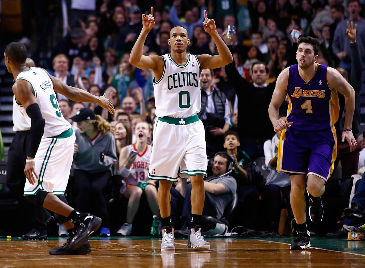 BOSTON, MA - JANUARY 17: Avery Bradley #0 of the Boston Celtics reacts following a three-point shot in the second half against the Los Angeles Lakers during the game at TD Garden on January 17, 2014 in Boston, Massachusetts. NOTE TO USER: User expressly acknowledges and agrees that, by downloading and or using this photograph, User is consenting to the terms and conditions of the Getty Images License Agreement. (Photo by Jared Wickerham/Getty Images)