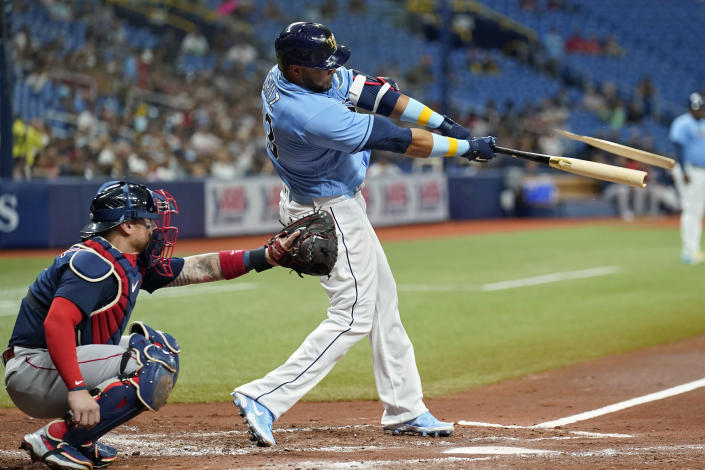Tampa Bay Rays' Nelson Cruz breaks his bat on a single off Boston Red Sox starting pitcher Martin Perez during the third inning of a baseball game Friday, July 30, 2021, in St. Petersburg, Fla. (AP Photo/Chris O'Meara)