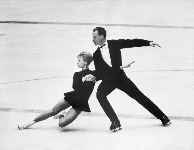 (Original Caption) 1/29/64-Innsbruck, Austria: Lumilla Belousova and Oleg Protopopov (Soviet Union) during their performance (she is dipping) in the Olympic pairs figure skating competition tonight in the Olympic Ice Stadium here. The Russian team won the Gold Medal with 104.4 points. The German team Marika Kilius and Hans-Jurgen Baummer placed second with 103.6 seconds.