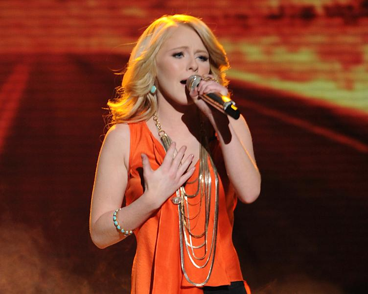 "In this May 9, 2012 photo released by Fox, contestant Hollie Cavanagh performs on the singing competition series ""American Idol,"" in Los Angeles. (AP Photo/Fox, Michael Becker)"