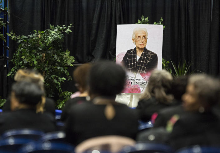 """A portrait of NASA mathematician Katherine Johnson faces guests prior to a memorial service in her honor on Saturday, March 7, 2020, at Hampton University Convocation Center in Hampton, Va. Johnson, a mathematician who calculated rocket trajectories and earth orbits for NASA's early space missions and was later portrayed in the 2016 hit film """"Hidden Figures,"""" about pioneering black female aerospace workers died on Monday, Feb. 24, 2020. She was 101. (Kaitlin McKeown /The Virginian-Pilot via AP)"""