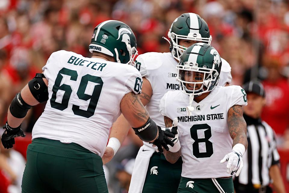 Michigan State wide receiver Jalen Nailor is congratulated by Blake Bueter after scoring a touchdown against Rutgers during the first half of an NCAA college football game Saturday, Oct. 9, 2021, in Piscataway, N.J. Michigan State won 31-13.