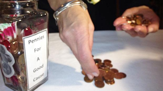 Ronna Goldberg counts donated pennies donated to Winnipeg Harvest.