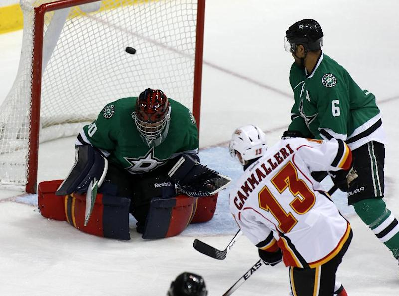 Dallas Stars goalie Tim Thomas (30) and defenseman Trevor Daley (6) give up a goal to Calgary Flames center Mike Cammalleri (13) in the second period of an NHL hockey game Friday, March 14, 2014, in Dallas. (AP Photo/Sharon Ellman)