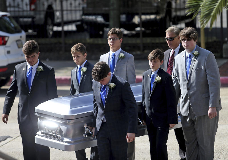 The Blanco family pallbearers bring the casket into the Cathedral during a Celebration of Life Interfaith Service for former Louisiana Gov. Kathleen Babineaux Blanco, at St. Joseph Cathedral in Baton Rouge, La., Thursday, Aug. 22, 2019. Thursday was the first of three days of public events to honor Blanco, the state's first female governor who died after a years long struggle with cancer.(AP Photo/Michael Democker, Pool)