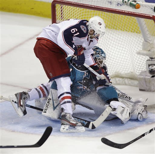 Columbus Blue Jackets right wing Rick Nash (61) crashes into San Jose Sharks goalie Antti Niemi (31), of Finland, in the first period on an NHL hockey game in San Jose, Calif., Tuesday, Jan. 31, 2012. (AP Photo/Paul Sakuma)
