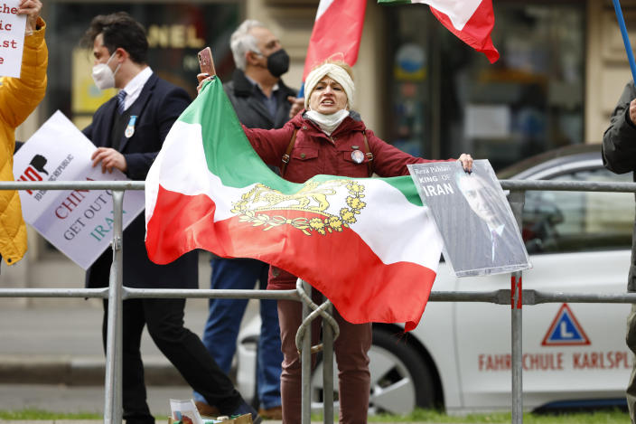 Demonstrators of an Iranian opposition group protest near the Grand Hotel Wien where closed-door nuclear talks with Iran take place, in Vienna, Austria, Thursday, April 15, 2021. (AP Photo/Lisa Leutner)