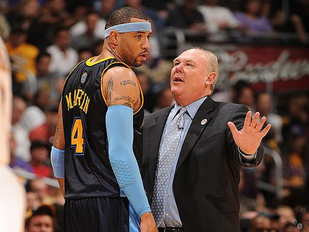 Kenyon Martin and George Karl chat it up. (Getty Images)