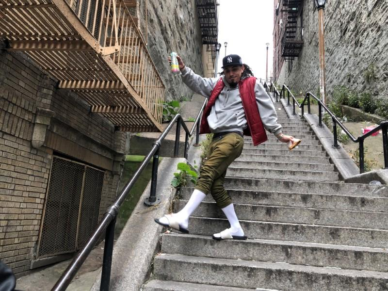 """Jay Garcia, a radio host from Queens, dances down the """"Joker Steps"""" in the Bronx"""