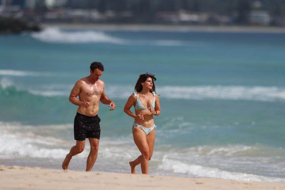 People run along Coolangatta beach in Gold Coast, Australia.