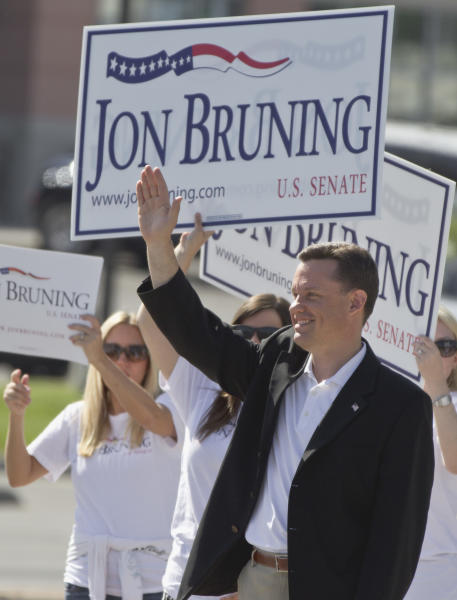 Nebraska Attorney Gen. Jon Bruning waves to passing motorists in Omaha, Neb., Tuesday, May 15, 2012. Bruning is competing against state Senator Deb Fischer and state Treasurer Don Stenberg in the Republican primary election for the U.S. Senate seat vacated by democrat Ben Nelson. (AP Photo/Nati Harnik)