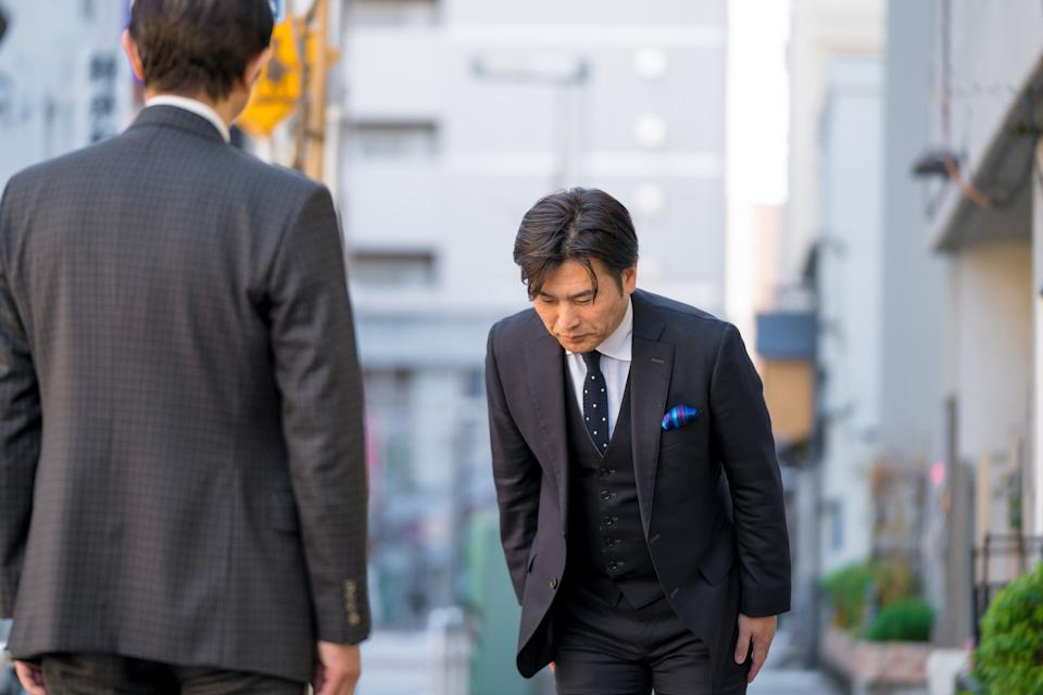 Mature Japanese businessman bowing to show respect. Tokyo, Japan. January 2018