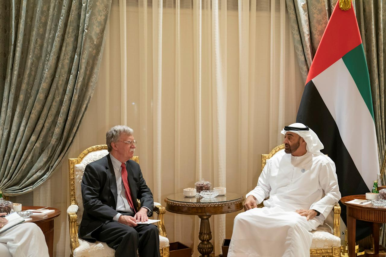 Abu Dhabi's Crown Prince Sheikh Mohammed bin Zayed al-Nahyan meets with U.S. National Security Adviser John Bolton in Abu Dhabi, United Arab Emirates, November 12, 2018. Picture taken November 12, 2018. WAM/Handout via REUTERS ATTENTION EDITORS - THIS PICTURE WAS PROVIDED BY A THIRD PARTY.
