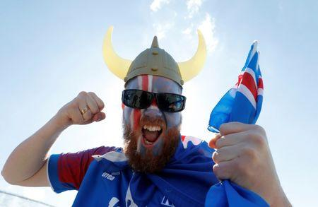 A supporter of Iceland cheers in Zaryadye Park Moscow, Russia - June 16, 2018. REUTERS/Sergei Karpukhin/Files